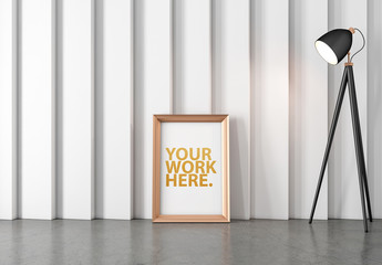 Gold Vertical Frame Leaning on Wall Next to Lamp Mockup