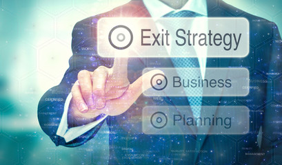 A business man selection a button on a futuristic display with a Exit Strategy concept written on it. Wall mural