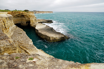 Aluminium Prints Cyprus Picturesque landscape with cliffs, rocky arch and stacks faraglioni, at Torre Sant Andrea, Salento sea coast, Puglia, Italy