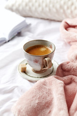 A cup of morning coffee in bed