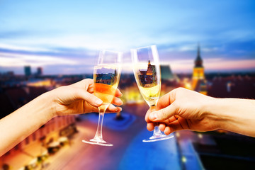 Warsaw Poland downtown with glasses of champagne