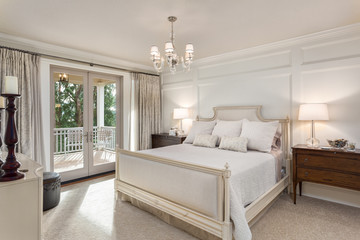 Beautiful master bedroom in new luxury traditional style home