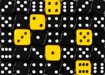 Background of random ordered black dices with six yellow cubes
