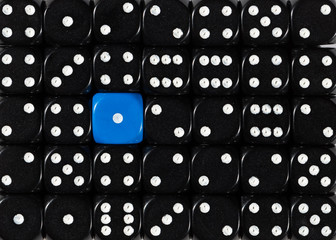 Background of random ordered black dices with one blue cube