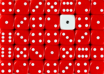 Background of random ordered red dices with one white cube