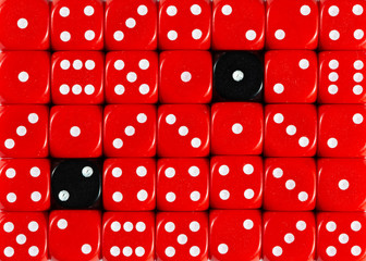 Background of random ordered red dices with two black cubes