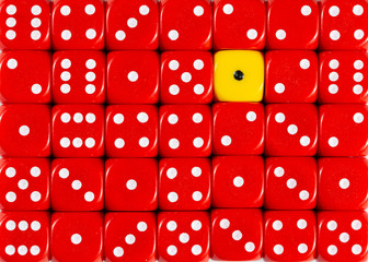 Background of random ordered red dices with one yellow cube