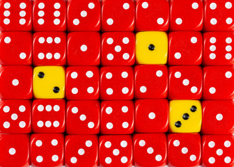 Background of random ordered red dices with three yellow cubes