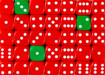 Background of random ordered red dices with three green cubes
