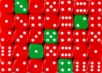 Background of random ordered red dices with five green cubes