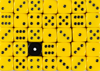 Background of random ordered yellow dices with one black cube