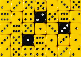 Background of random ordered yellow dices with three black cubes