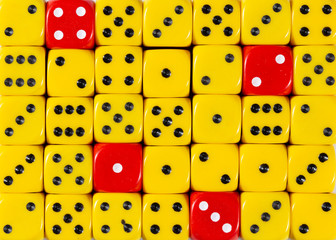 Background of random ordered yellow dices with four red cubes