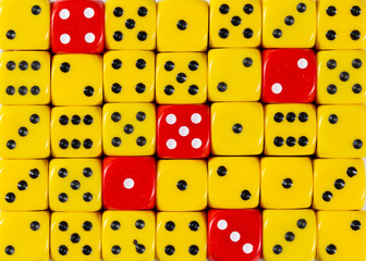 Background of random ordered yellow dices with five red cubes