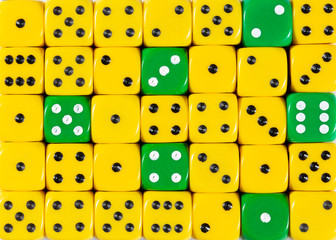 Background of random ordered yellow dices with six green cubes