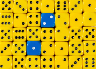 Background of random ordered yellow dices with two blue cubes