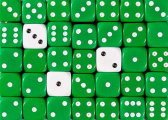 Background of random ordered green dices with three white cubes