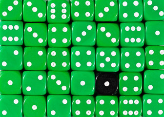 Background of random ordered green dices with one black cube