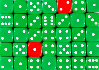 Background of random ordered green dices with two red cubes