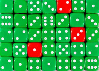 Background of random ordered green dices with three red cubes