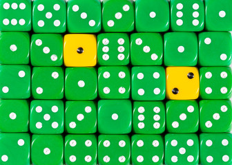 Background of random ordered green dices with two yellow cubes