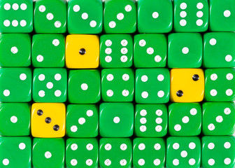 Background of random ordered green dices with three yellow cubes