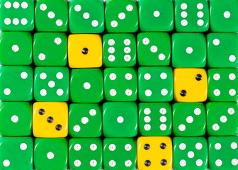 Background of random ordered green dices with four yellow cubes