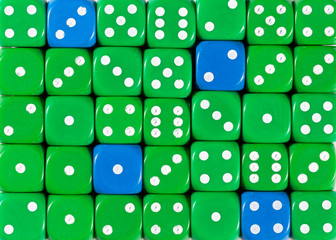 Background of random ordered green dices with four blue cubes