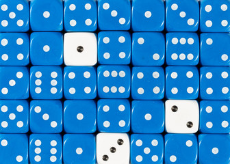 Background of random ordered blue dices with three white cubes
