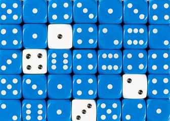 Background of random ordered blue dices with four white cubes