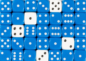Background of random ordered blue dices with five white cubes