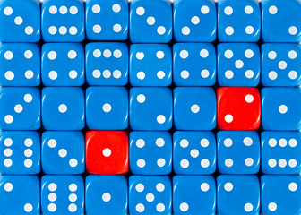 Background of random ordered blue dices with two red cubes
