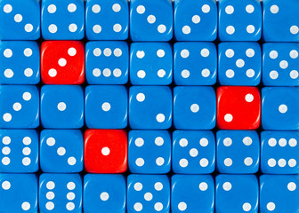 Background of random ordered blue dices with three red cubes