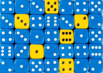 Background of random ordered blue dices with six yellow cubes