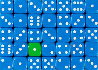 Background of random ordered blue dices with one green cube