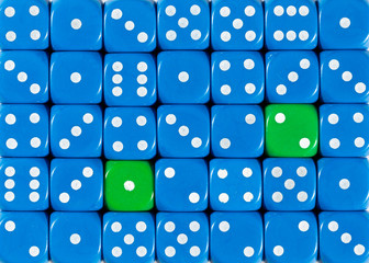 Background of random ordered blue dices with two green cubes