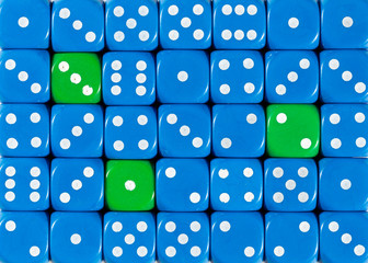 Background of random ordered blue dices with three green cubes