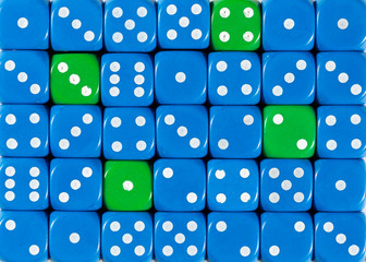 Background of random ordered blue dices with four green cubes