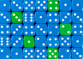 Background of random ordered blue dices with five green cubes