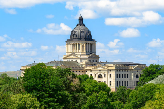 South Dakota Capitol Building under blue sky with clouds