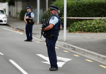 Police stand guard after Friday's mosque attacks, outside Masjid Al Noor in Christchurch