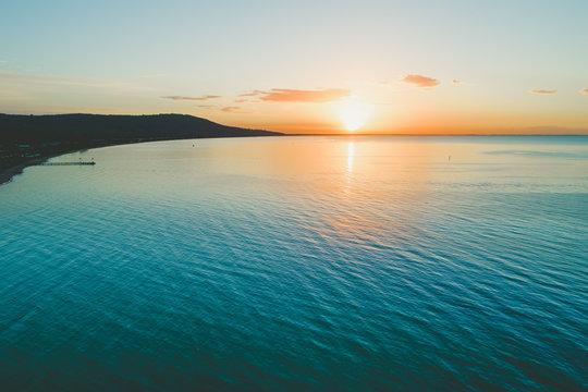 Aerial view of scenic sunset over ocean coastline