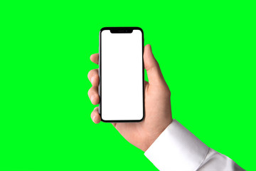 Business man holding modern smartphone, blank screen, greenscreen background template, isolated