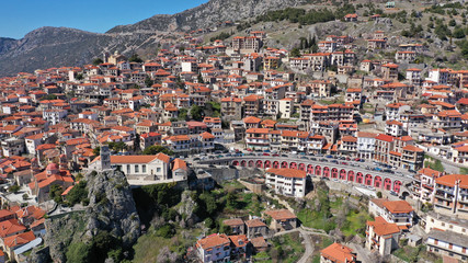 Aerial drone photo from famous and picturesque village of Arachova built on the slope of Parnassus mountain with traditional character at spring, Voiotia, Greece
