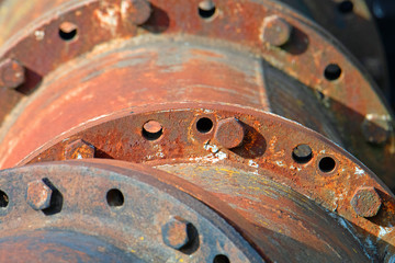 Old industrial machinery wheel detail. Rusty. Old pumping station - for water.
