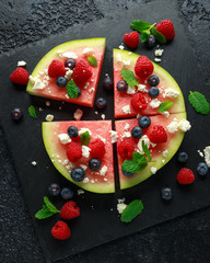 Juicy watermelon pizza with blueberries, raspberry feta cheese, mint. party food