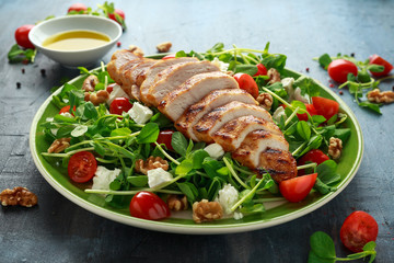 Fresh Grilled Chicken salad with tomatoes, feta cheese and vegetables