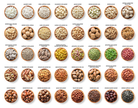 collection nuts and seeds isolated on white background. pecans, hazelnuts, walnuts, pistachios, almonds, macadamia, cashews, peanuts, sunflower, coconut, apricot kernel, pumpkin seeds, pine and brazil