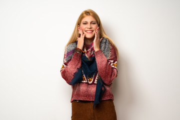 Hippie woman over white wall smiling with a happy and pleasant expression
