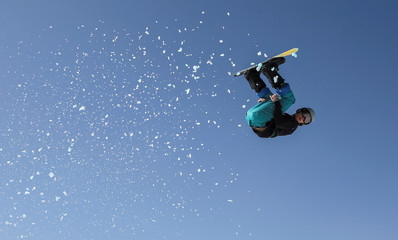An athlete soars during a snowboarding and freestyle skiing festival outside Almaty